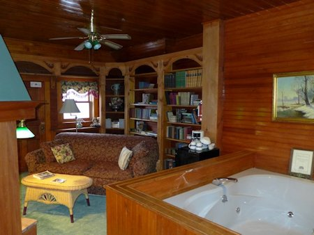 Suite 10s library-sitting room and whirlpool tub