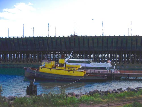 Tugboat in Two Harbors. Image via http://www.superiortrails.com/mn2005images/tugwoo0078.jpg