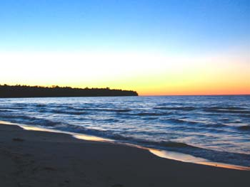 lake superior sunsrise over bayfield peninsula